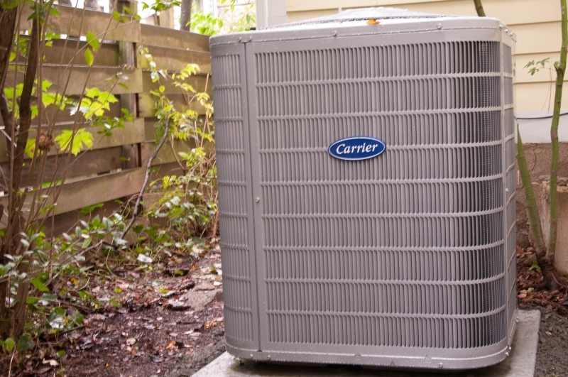 An outdoor residential Carrier air conditioning unit installed in Princeton, NJ