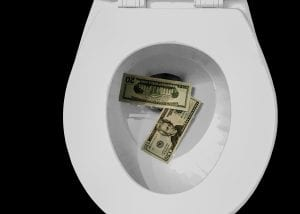 Money being flushed down the toilet